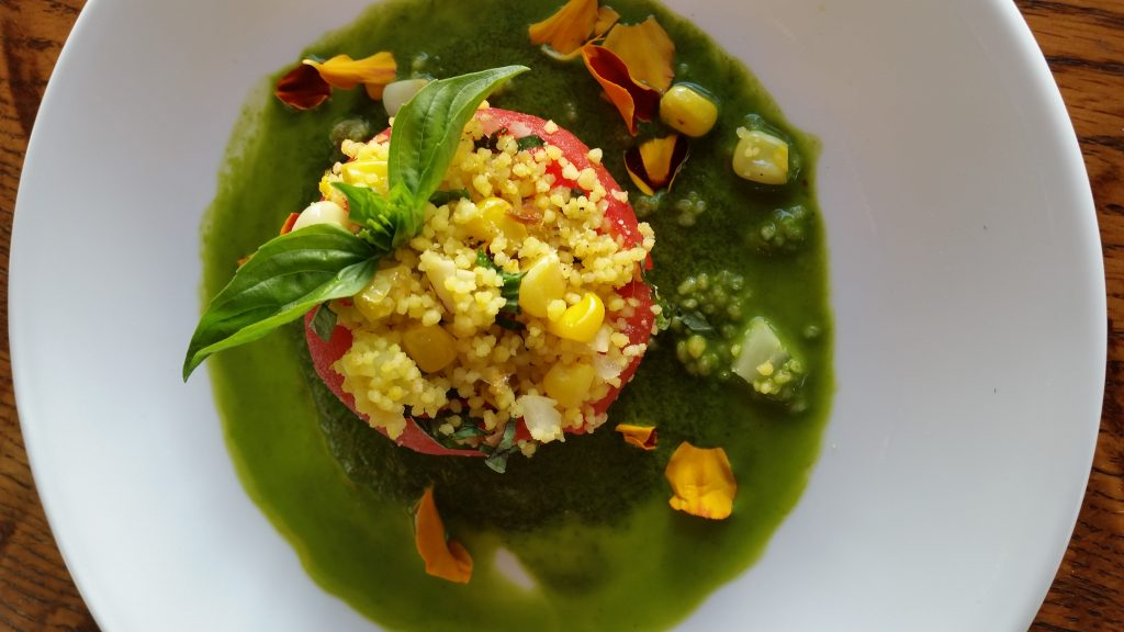 Stuffed Heirloom Tomatoes with Cous Cous, Corn, Almonds, Basil, and Cilantro Puree